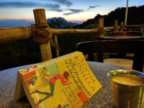Book, beverage, and scenic beauty